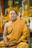 Buddhist monk. From Thailand in traditional orange garb Stock Image