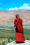Buddhist monk against mountains in the Himalayas Royalty Free Stock Image
