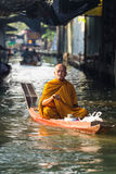 Buddhist monk is the alms on morning Royalty Free Stock Image