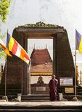 Buddhist monk and ancient gates. royalty free stock photos