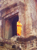 Buddhist monk Angkor Wat. Buddhist Monk serenely contemplates the view from the top of Angkor Wat Stock Image