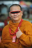 Buddhist Monk. A Buddhist monk attends a Red Shirt rally on September 15, 2012 in Bangkok, Thailand. The political rally was held to mark the 6th anniversary of Stock Image