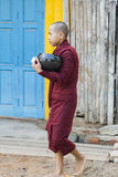 Buddhist monk with begging bowl Stock Images