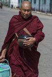 Buddhist monk with begging bowl Stock Photo