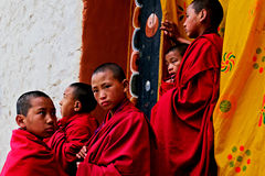 Buddhist Monk In Bhutan. Paro,Bhutan,Asia- Buddhist monks near Paro Dzong in the Kingdom of Bhutan. The Buddhism practiced in the country today is a vibrant Stock Photography