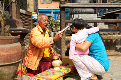 Buddhist monk blessing people Royalty Free Stock Photos