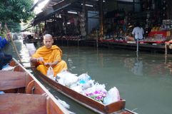 The Buddhist monk on boat Stock Images