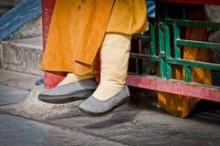 Buddhist monk. Close up on buddhist monk's shoes Stock Photos