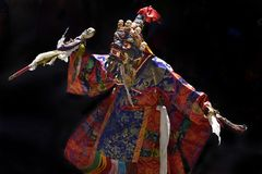 Buddhist monk in costume Palden Lhamo with wand in his hands replaces the Tantric Dance Mask. Buddhist monk in costume Palden Lhamo with a wand in his hands Stock Photography