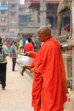 A Buddhist monk counting donated money Royalty Free Stock Photos