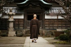 Buddhist monk. A monk in court yard of a monastery in Kamakura, Japan Royalty Free Stock Images