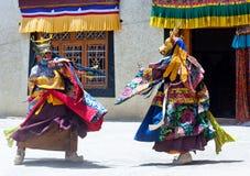 Buddhist monk dancing Cham mystery in Lamayuru, India Royalty Free Stock Photo