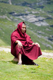 Buddhist monk is deep in thought Stock Images