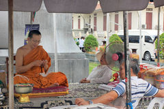 Buddhist monk discussing ouside some buddhist temple, Thailand stock image