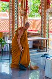 Buddhist monk doing some cleaning at buddhist temple from Damnoen Saduak Floating Market Royalty Free Stock Images
