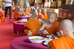 Buddhist monk eat lunch in asian temple Stock Photos