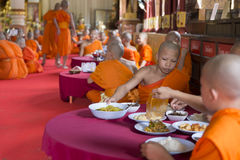 Buddhist monk eat lunch in asian temple Stock Photo