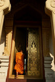 Buddhist Monk entering temple Royalty Free Stock Images