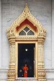 Buddhist monk entering temple at Wat Benchamabophit Dusitvanaram. Bangkok, Thailand Stock Photography