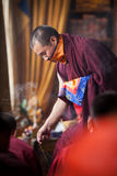 The Buddhist monk fumigates the room with ritual incense. Royalty Free Stock Photo