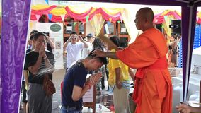 Buddhist monk gives water blessing