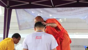 Buddhist monk gives water blessing close up
