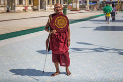 Buddhist monk goes on pilgrimage to Botataung Pagoda in Yangon, Myanmar Stock Photo
