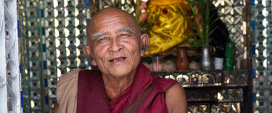 Buddhist monk goes on pilgrimage to Botataung Pagoda in Yangon, Myanmar Royalty Free Stock Photo