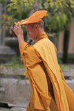 Buddhist monk. Goes to the service Royalty Free Stock Photo