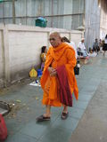 The Buddhist monk going along streets of the market Royalty Free Stock Photos
