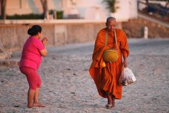 Buddhist monk on his daily collection stock photo