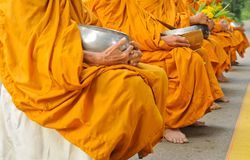 Buddhist monk hold bowl. Buddhist monk hold alms bowl Stock Photography