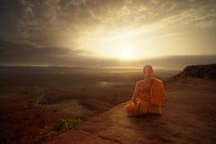 Free Buddhist Monk In Meditation At Beautiful Sunset Or Sunrise Background Royalty Free Stock Image - 136512266