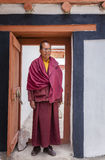 Buddhist monk. Ladakh, India - July 10, 2016: Portrait of a Buddhist monk in traditional robe at a monastery in Ladakh, Kashmir, India Stock Photo