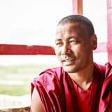 Buddhist monk. Ladakh, India - July 10, 2016: Portrait of a Buddhist monk in traditional robe at a monastery in Ladakh, Kashmir, India Stock Photography