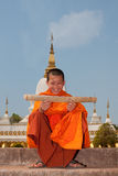 Buddhist monk in Laos. While reading old writings Royalty Free Stock Images