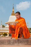 Buddhist monk in Laos. While reading old writings Royalty Free Stock Image