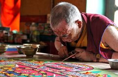 Buddhist monk making sand mandala Stock Image