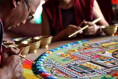 Buddhist monk making sand mandala Royalty Free Stock Photos