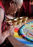 Buddhist monk making sand mandala Stock Photos