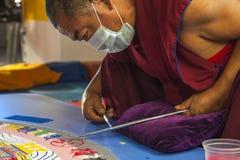 Buddhist monk making sand mandala Royalty Free Stock Image
