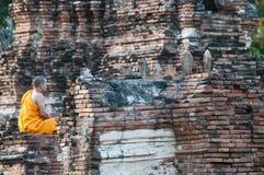 Buddhist monk in meditation. Buddhist monk in meditation at Wat Chai  Wattanaram, Ayutthaya, Thailand. The temple was built in 1629 by King Prasat Tong Stock Photos