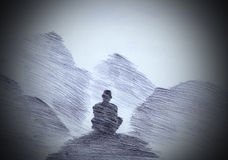 Buddhist monk in the mountains. Buddhist monk meditating in the mountains Royalty Free Stock Photo