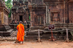 Buddhist monk observing Banteay Srei Temple, Cambodia Royalty Free Stock Photography