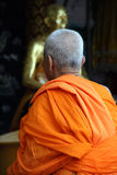 Buddhist monk in orange robe Royalty Free Stock Photography