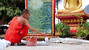 Buddhist monk painted decorative castings stock video footage