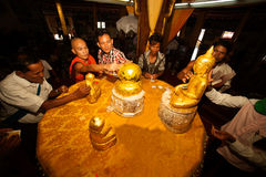 Buddhist Monk and peoples are gilding leaf a small Buddha. Stock Image