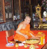 BUDDHIST MONK PERFORMING PRAYERS stock photography
