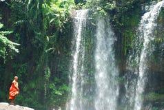 Buddhist monk. Phnom Kulen waterfall. Cambodia. Phnom Kulen National Park is a National park in Cambodia. It is located in the Phnom Kulen mountain massif in Royalty Free Stock Photo