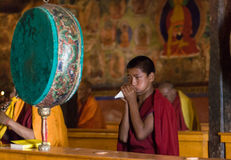 Buddhist monk playing on shell royalty free stock photo